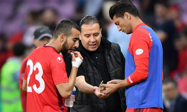 Tunisia's head coach Nabil Maâloul distributes dates to midfielder Naïm Sliti, left, and defender Rami Bedoui during the friendly with Turkey. Maâloul said he had asked his goalkeeper, Mouez Hassen, to simulate an injury in warm-up games to allow his players to break the fast.