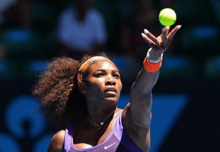 Serena Williams serves against compatriot Sloane Stephens during their clash at the Australian Open on January 23, 2013