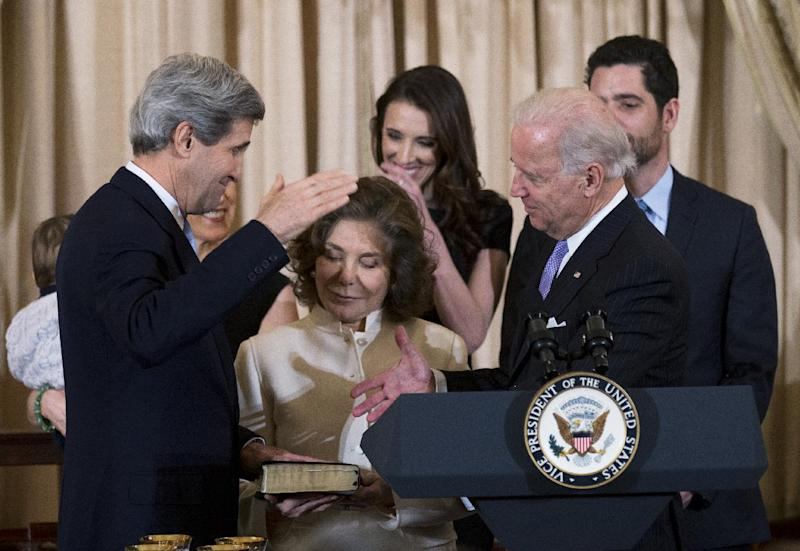 Secretary of State John Kerry, left, with his wife Teresa Heinz Kerry, center, holding the Bible, is ceremonially sworn-in as the 68th Secretary of State by Vice President Joe Biden, right, at the State Department in Washington, Wednesday, Feb. 6, 2013. Witnessing the ceremony are  Kerry's daughters Vanessa Kerry, obscured, and Alexandra Kerry, back center, and  stepson Christopher Heinz, back right.   (AP Photo/Manuel Balce Ceneta)