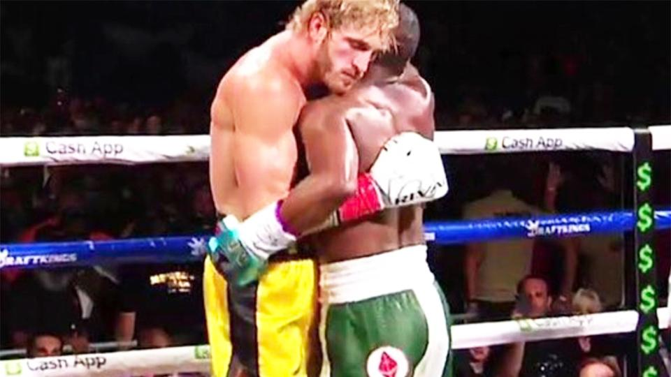 Logan Paul (pictured left) wrapping-up Floyd Mayweather (pictured right) during their bout fight.