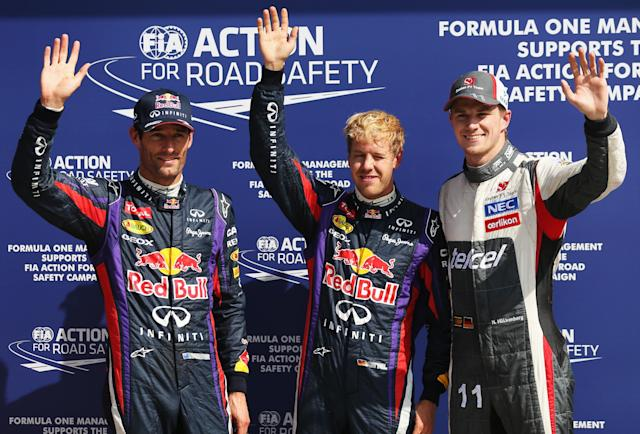 MONZA, ITALY - SEPTEMBER 07: Sebastian Vettel (C) of Germany and Infiniti Red Bull Racing celebrates finishing first alongside second placed Mark Webber (L) of Australia and Infiniti Red Bull Racing and third placed Nico Hulkenberg (R) of Germany and Sauber F1 following qualifying for the Italian Formula One Grand Prix at Autodromo di Monza on September 7, 2013 in Monza, Italy. (Photo by Mark Thompson/Getty Images)