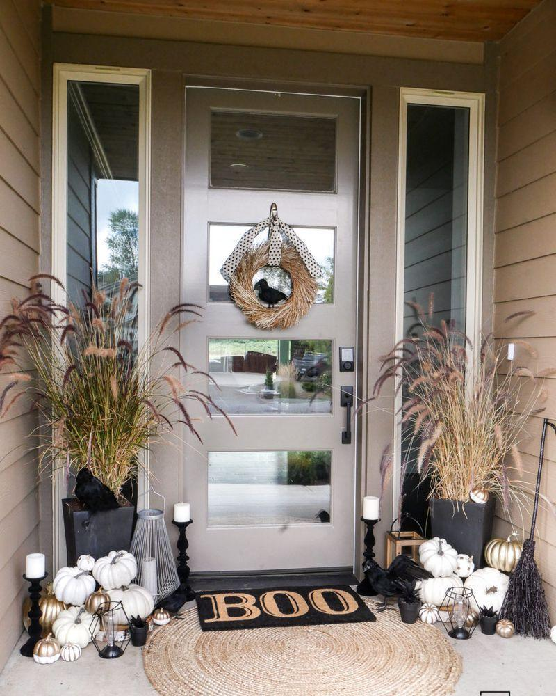 """<p>There's no need to go all-out when it comes to your Halloween décor. Instead, select an assortment of general autumnal decorations that will work well throughout the season, then supplement with a few Halloween-specific touches.</p><p><strong>Get the tutorial at <a href=""""https://tarynwhiteaker.com/black-and-white-halloween-porch-decorations/"""" rel=""""nofollow noopener"""" target=""""_blank"""" data-ylk=""""slk:Taryn Whiteaker"""" class=""""link rapid-noclick-resp"""">Taryn Whiteaker</a>.</strong></p><p><a class=""""link rapid-noclick-resp"""" href=""""https://go.redirectingat.com?id=74968X1596630&url=https%3A%2F%2Fwww.walmart.com%2Fsearch%2F%3Fquery%3Dpolka%2Bdot%2Bribbon&sref=https%3A%2F%2Fwww.thepioneerwoman.com%2Fholidays-celebrations%2Fg32894423%2Foutdoor-halloween-decorations%2F"""" rel=""""nofollow noopener"""" target=""""_blank"""" data-ylk=""""slk:SHOP POLKA DOT RIBBON"""">SHOP POLKA DOT RIBBON</a></p>"""