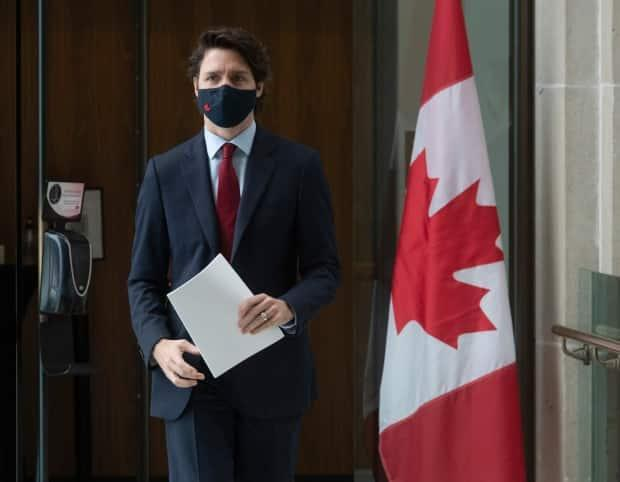 Prime Minister Justin Trudeau makes his way to a news conference in Ottawa on Friday. After convening a call with Canada's premiers on Thursday evening, Trudeau said Ottawa is working with the provinces and territories to ensure they're ready to dole out more vaccines.