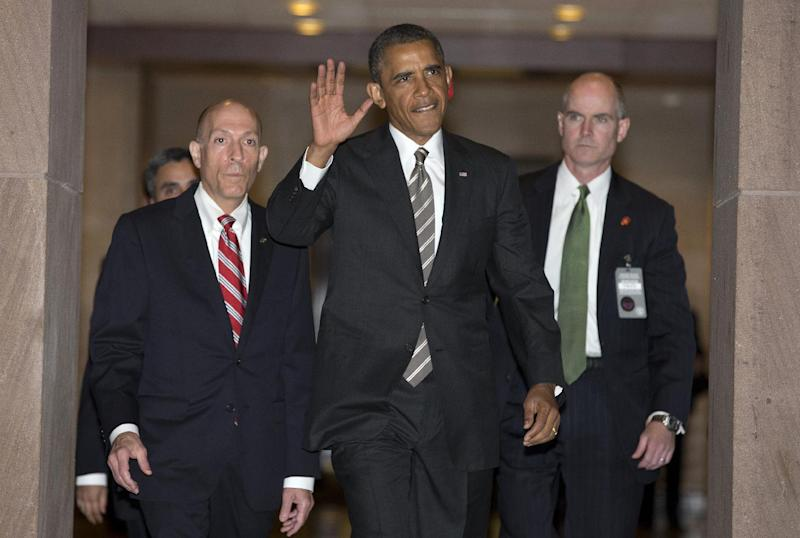 President Barack Obama waves as he arrives on Capitol Hill in Washington, Wednesday, July 31, 2013, to meet with the House Democratic Caucus. There's a new cadence to President Barack Obama's musings about Congress: Why can't House Republicans be more like their mates in the Senate? As Obama presses his economic agenda across the country, he's playing one chamber against the other, hoping Americans will hear his calls for compromise and conclude it's not his fault almost nothing is getting done in Washington. (AP Photo/Evan Vucci)