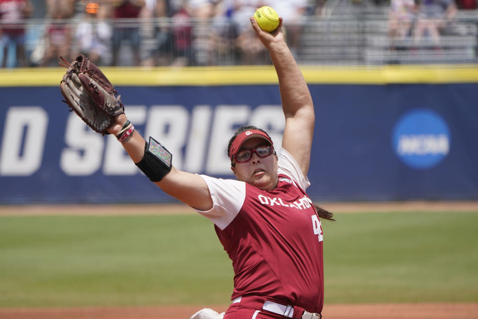 Oklahoma's Giselle Juarez (45) pitches in the first inning against Florida State in the final game of the NCAA Women's College World Series softball championship series Thursday, June 10, 2021, in Oklahoma City. (AP Photo/Sue Ogrocki)