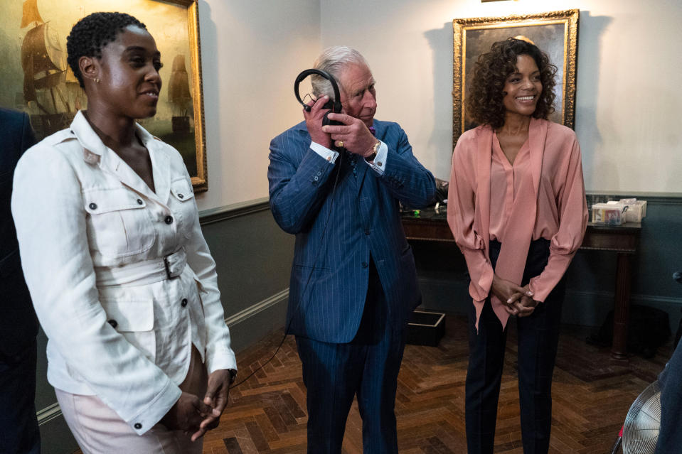 IVER HEATH, ENGLAND - JUNE 20: Prince Charles, Prince of Wales meets British actors Lashana Lynch (L) and Naomie Harris (R) as he tours the set of the 25th James Bond Film at Pinewood Studios on June 20, 2019 in Iver Heath, England.  The Prince of Wales, Patron, The British Film Institute and Royal Patron, the Intelligence Services toured the set of the 25th James Bond Film to celebrate the contribution the franchise has made to the British film industry. (Photo by Niklas Halle'n - WPA Pool/Getty Images)
