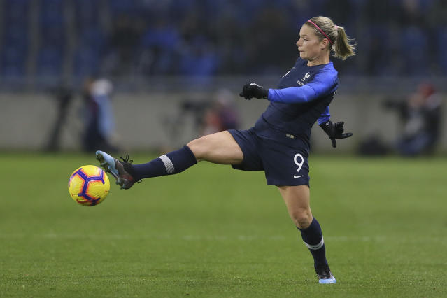 FILE - In this Jan. 19, 2019, file photo, France's Eugenie Le Sommer lunges for the ball during a women's international friendly soccer match against the United States at the Oceane stadium in Le Havre, France. (AP Photo/David Vincent, File