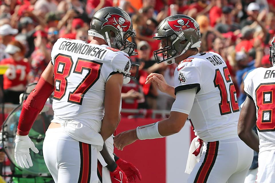 TAMPA, FL - SEPTEMBER 19: Tampa Bay Buccaneers Tight End Rob Gronkowski (87) scores a touchdown and is congratulated by Quarterback Tom Brady (12) during the regular season game between the Atlanta Falcons and the Tampa Bay Buccaneers on September 19, 2021 at Raymond James Stadium in Tampa, Florida. (Photo by Cliff Welch/Icon Sportswire via Getty Images)