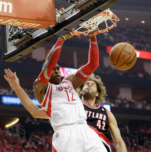 HOUSTON, TX - APRIL 30: Dwight Howard #12 of the Houston Rockets dunks over Robin Lopez #42 of the Portland Trail Blazers in Game 5 of the Western Conference Quarterfinals during the 2014 NBA Playoffs at the Toyota Center on April 30, 2014 in Houston, Texas. (Photo by Bob Levey/Getty Images)