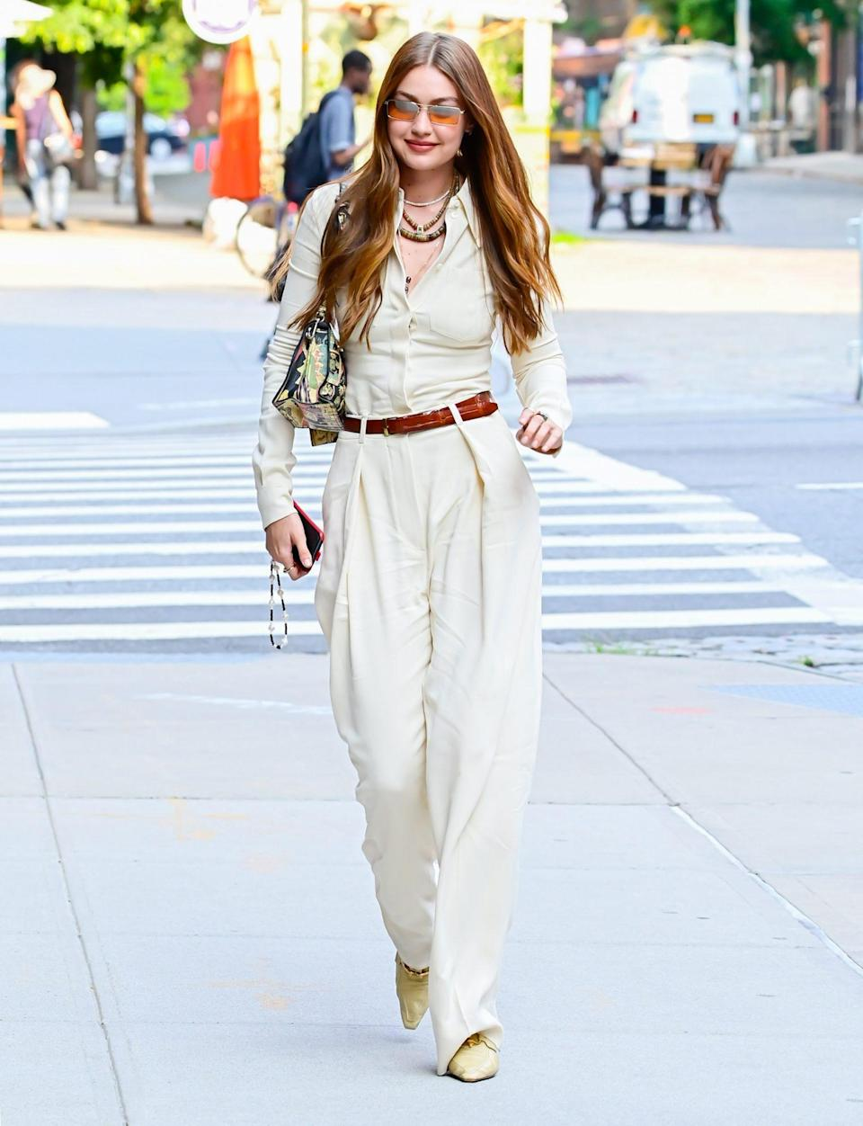 <p>New mom Gigi Hadid steps out for a walk in N.Y.C.'s Soho neighborhood on July 15.</p>
