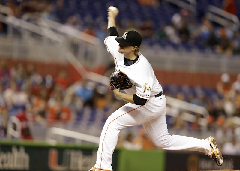 Miami Marlins starting pitcher Tom Koehler throws during the first inning of the MLB National League baseball game against the Washington Nationals, Tuesday, April 15, 2014, in Miami. (AP Photo/Lynne Sladky)
