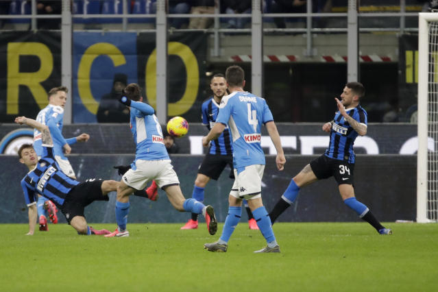 Napoli's Fabian Ruiz, third from left, scores his side's first goal during an Italian Cup soccer match between Inter Milan and Napoli at the San Siro stadium, in Milan, Italy, Wednesday, Feb. 12, 2020. (AP Photo/Luca Bruno)