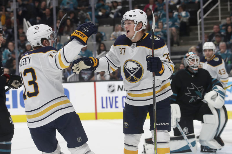 Buffalo Sabres center Casey Mittelstadt (37) is congratulated by left wing Jimmy Vesey after scoring a goal against the San Jose Sharks during the second period of an NHL hockey game in San Jose, Calif., Saturday, Oct. 19, 2019. (AP Photo/Jeff Chiu)