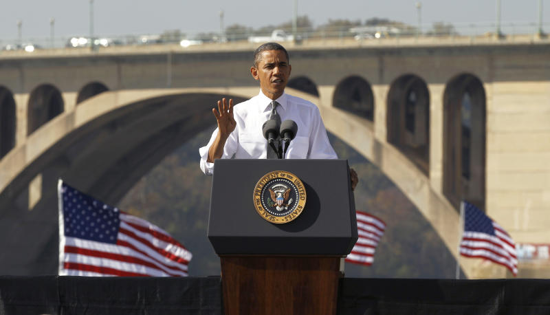 FILE - In this Nov. 2, 2011, file photo, President Barack Obama speaks in front of the Key Bridge in Washington. In his weekly radio address Saturday, March 24, 2012, Obama is encouraging voters to pressure Democrats and Republicans to pass a long-term transportation bill. He says the economy will take a hit otherwise as construction projects sit idle, and calls for Congress to adopt the two-year $109 billion bill the Senate passed overwhelmingly last week. (AP Photo/Pablo Martinez Monsivais, File)