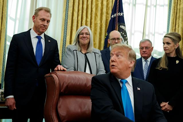 "Patrick Shanahan listens as President Trump speaks during a signing event for ""Space Policy Directive 4"" on Feb. 19. (Photo: Evan Vucci/AP)"