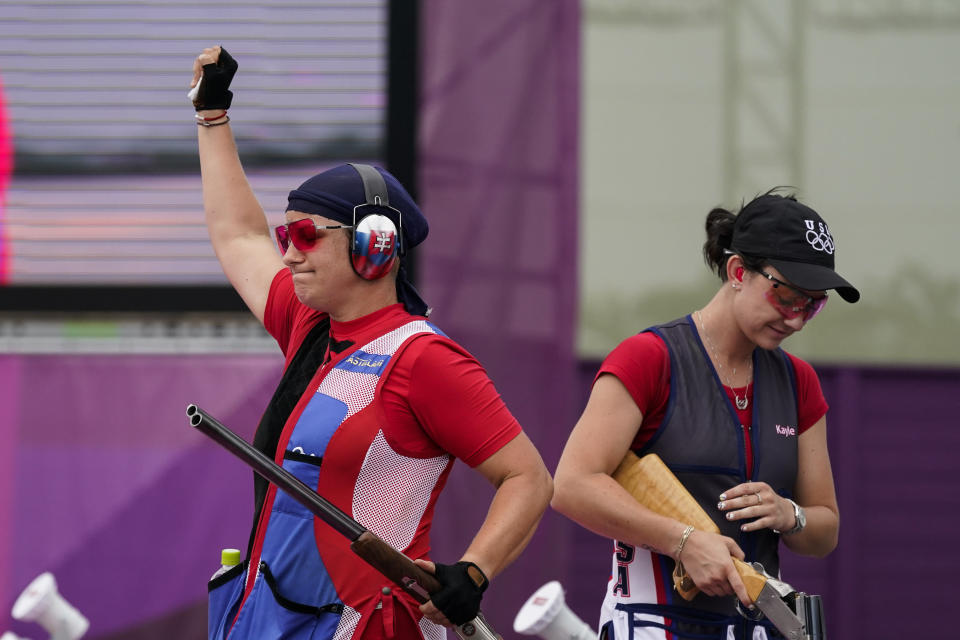 Zuzana Rehak Stefecekova, left, of Slovakia, celebrates taking the gold as Kayle Browning, of the United States, takes the gold in the women's trap at the Asaka Shooting Range in the 2020 Summer Olympics, Thursday, July 29, 2021, in Tokyo, Japan. (AP Photo/Alex Brandon)