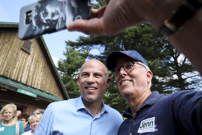 Michael Avenatti, left, an attorney and entrepreneur, has a selfie taken with Mike Munhall of Bennington after speaking at the Hillsborough County Democrats' Summer Picnic fundraiser in Greenfield, N.H., Sunday, Aug. 19, 2018. Avenatti, the attorney taking on President Donald Trump over his alleged affair with an adult film actress, is exploring a possible 2020 run for president. (AP Photo/ Cheryl Senter)