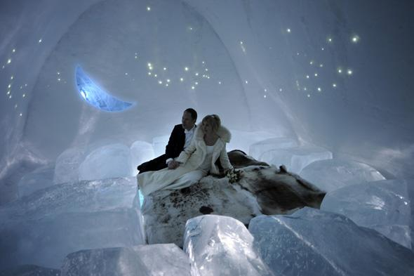A couple pose for pictures after being married at the chapel of the ice hotel in Jukkasjaervi on January 9, 2009. Around 150 marriages happen at the chapel each winter. The chapel and ice hotel are temporary buildings since the structure of the chapel and of the ice hotel melts away in spring. AFP PHOTO/OLIVIER MORIN (Photo credit should read OLIVIER MORIN/AFP/Getty Images)