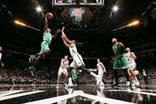 BROOKLYN, NY - OCTOBER 19: Jeff Green #8 of the Boston Celtics goes for the dunk against the Brooklyn Nets during the game on October 19, 2014 at Barclays Center in Brooklyn, New York. (Photo by Nat Butler/NBAE via Getty Images)