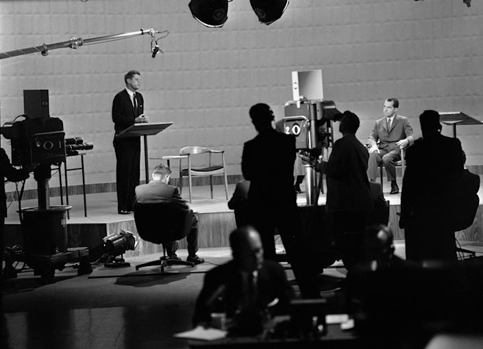 John F. Kennedy, left, speaks during the debate with Richard M. Nixon, seated on September 26, 1960 in Chicago.  (CBS via Getty Images)