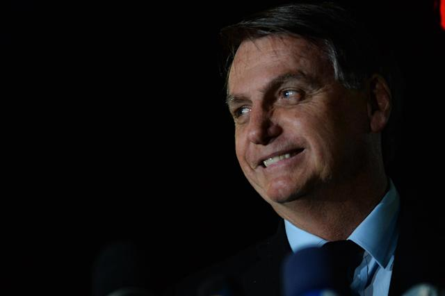 BRASILIA, BRAZIL - JUNE 05: President of Brazil Jair Bolsonaro smiles during a conference with the press and supporters at Alvorada Palace on June 05, 2020 in Brasilia, Brazil. Brazil has over 614,000 confirmed positive cases of Coronavirus and OVER 34,000 deaths. (Photo by Andressa Anholete/Getty Images)