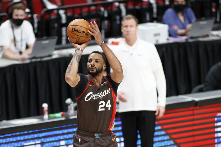 Norman Powell in a shooting motion with the ball over his head.