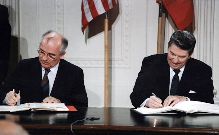 """<span class=""""caption"""">As the Cold War came to an end, the U.S. and the Soviet Union both began reducing their numbers of nuclear weapons, setting the stage for the testing ban.</span> <span class=""""attribution""""><a class=""""link rapid-noclick-resp"""" href=""""https://commons.wikimedia.org/wiki/File:Reagan_and_Gorbachev_signing.jpg"""" rel=""""nofollow noopener"""" target=""""_blank"""" data-ylk=""""slk:White House Photographic Office"""">White House Photographic Office</a></span>"""
