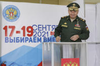 In this handout photo released by the Russian Defense Ministry Press Service, Russian Defense Minister Sergei Shoigu smiles as he casts his ballot at a polling station during the Parliamentary elections in Moscow, Russia, Friday, Sept. 17, 2021. Russia has begun three days of voting for a new parliament that is unlikely to change the country's political complexion. There's no expectation that United Russia, the party devoted to President Vladimir Putin, will lose its dominance in the State Duma. (Vadim Savitsky/Russian Defense Ministry Press Service via AP)