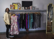 Fashion designer Kevan Hall pauses for a picture with his at his haute couture atelier in West Los Angeles Thursday, March 18, 2021. Fashion retailers and designers had dramatically shifted their offerings more toward casual clothes and away from dressier items since the pandemic. But, they face a conundrum as they design clothing for the summer and fall in the next few weeks. (AP Photo/Damian Dovarganes)