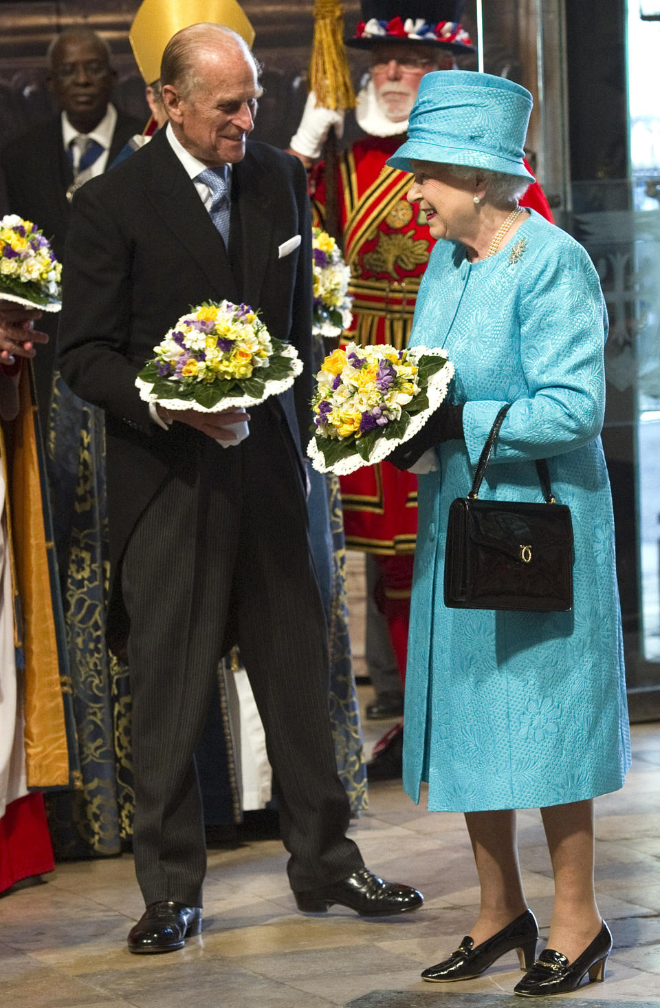 Britain's Queen Elizabeth II (R) and her husband Prince Philip attend the Maundy Service at Westminster Abbey on April 21, 2011, on the occasion of the Queen's 85th birthday. AFP PHOTO/ARTHUR EDWARDS/POOL (Photo credit should read ARTHUR EDWARDS/AFP via Getty Images)