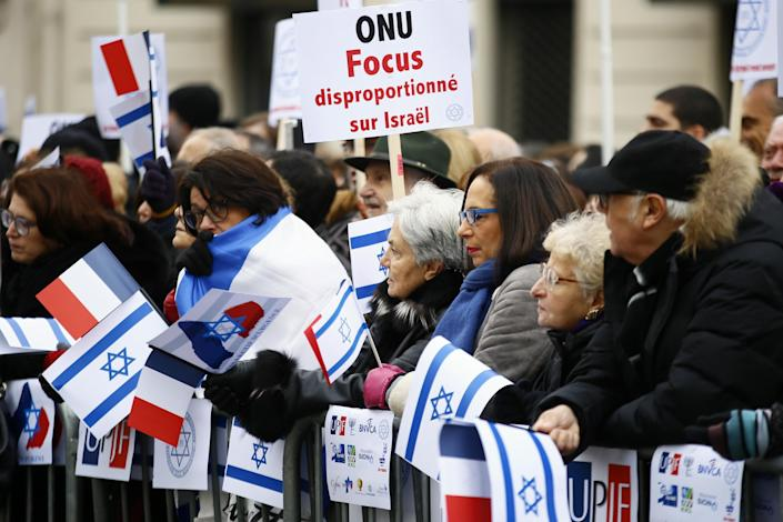 "Pro-Israel demonstrators hold a placard reading ""United Nations Organization Disproportionate Focus on Israel"" during a gathering in front of Israel embassy in Paris, France, Sunday, Jan. 15, 2017. Fearing a new eruption of violence in the Middle East, more than 70 world diplomats gathered in Paris on Sunday to push for renewed peace talks that would lead to a Palestinian state. (AP Photo/Francois Mori)"
