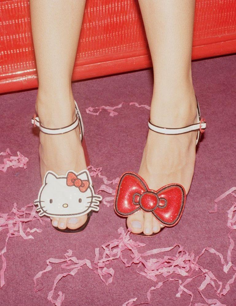"""<p><a rel=""""nofollow noopener"""" href=""""http://www.asos.com/asos/hello-kitty-x-asos-heeled-sandals-with-removable-badges/prd/8391298?"""" target=""""_blank"""" data-ylk=""""slk:Hello Kitty X ASOS Heeled Sandals With Removable Badges, £55"""" class=""""link rapid-noclick-resp"""">Hello Kitty X ASOS Heeled Sandals With Removable Badges, £55</a></p>"""