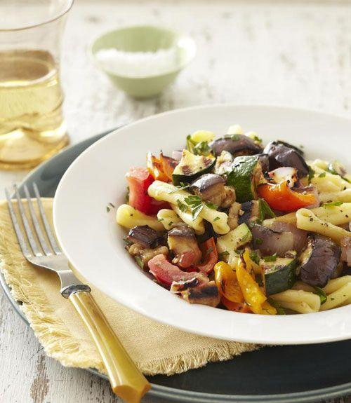 """<p>With colorful peppers, red onion and ripe plum tomatoes, this recipe is bursting with flavor.</p><p><a href=""""https://www.goodhousekeeping.com/food-recipes/a11160/grilled-ratatouille-pasta-recipe-ghk0811/"""" rel=""""nofollow noopener"""" target=""""_blank"""" data-ylk=""""slk:Get the recipe for Grilled Ratatouille Pasta »"""" class=""""link rapid-noclick-resp""""><em>Get the recipe for Grilled Ratatouille Pasta »</em></a></p>"""