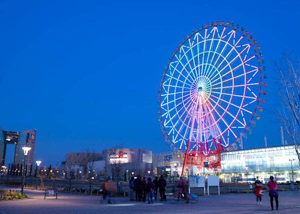 Palette Town's Big Ferris Wheel brings color to the night sky.