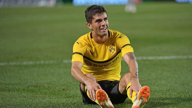 "U.S. men's national team standout <a class=""link rapid-noclick-resp"" href=""/soccer/players/613659/"" data-ylk=""slk:Christian Pulisic"">Christian Pulisic</a> suffered a calf injury playing for German club <a class=""link rapid-noclick-resp"" href=""/soccer/teams/borussia-dortmund/"" data-ylk=""slk:Borussia Dortmund"">Borussia Dortmund</a>."