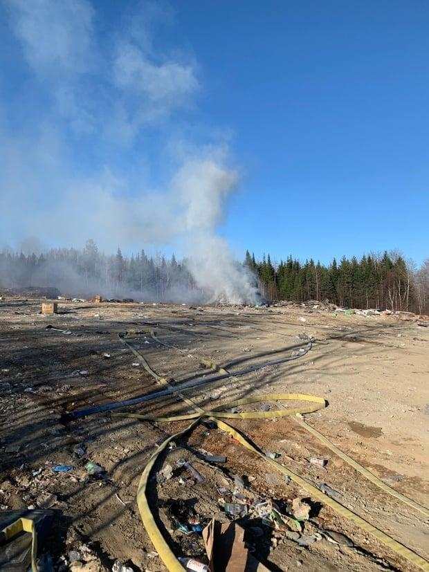 Local Waswanipi fire captain Frank Dixon says they are called to put out about 15 dump fires a year at the local dump located just 15 kilometres away from the community. Yesterday was the first time he saw one ignite a forest fire.  (Submitted by Frank Dixon - image credit)