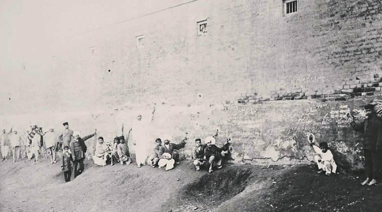 Locals show the bullet-holes in the southern wall of the Jallianwala Bagh towards the western side. (Source: Amandeep Singh Madra)