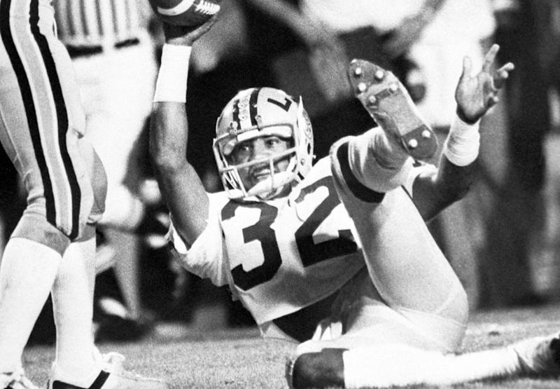 An LSU track star and football standout who was drafted by the Denver Broncos, Orlando McDaniel is dead at 59. (Associated Press)