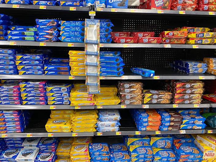 stacks of oreos and chips ahoy on shelves at a walmart