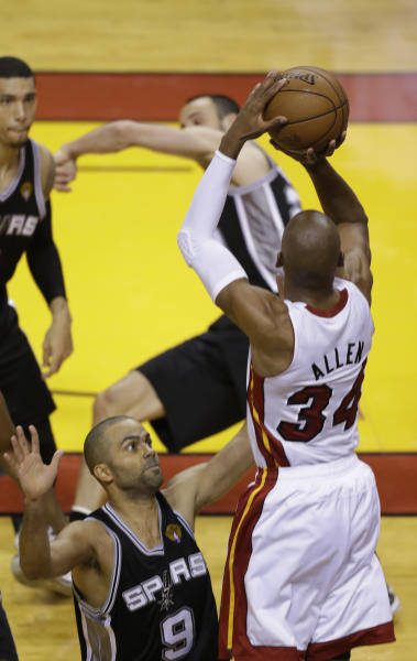 FILE - In this June 19, 2013 file photo, Miami Heat guard Ray Allen (34) aims a three-point shot as San Antonio Spurs guard Tony Parker (9) defends during Game 6 of the NBA Finals basketball game, in Miami. Allen's shot sent the game into overtime. For Ray Allen, it was The Summer of The Shot. Everywhere he went, all anyone wanted to talk to him about was the 3-pointer with 5.2 seconds left in Game 6 of the NBA Finals, the one that saved the Miami Heat title chances. And Allen didn't mind one bit, but even he says it's time to get ready for a new year. (AP Photo/Wilfredo Lee, File)