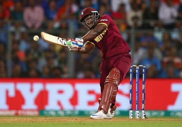 MUMBAI, INDIA - MARCH 31: Andre Russell of the West Indies bats during the ICC World Twenty20 India 2016 Semi Final match between West Indies and India at Wankhede Stadium on March 31, 2016 in Mumbai, India. (Photo by Ryan Pierse/Getty Images)