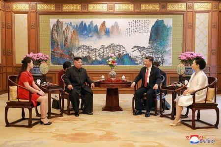Chinese President Xi Jinping talks with North Korean leader Kim Jong Un during his visit in Beijing, China, in this undated photo released June 20, 2018 by North Korea's Korean Central News Agency. KCNA via REUTERS