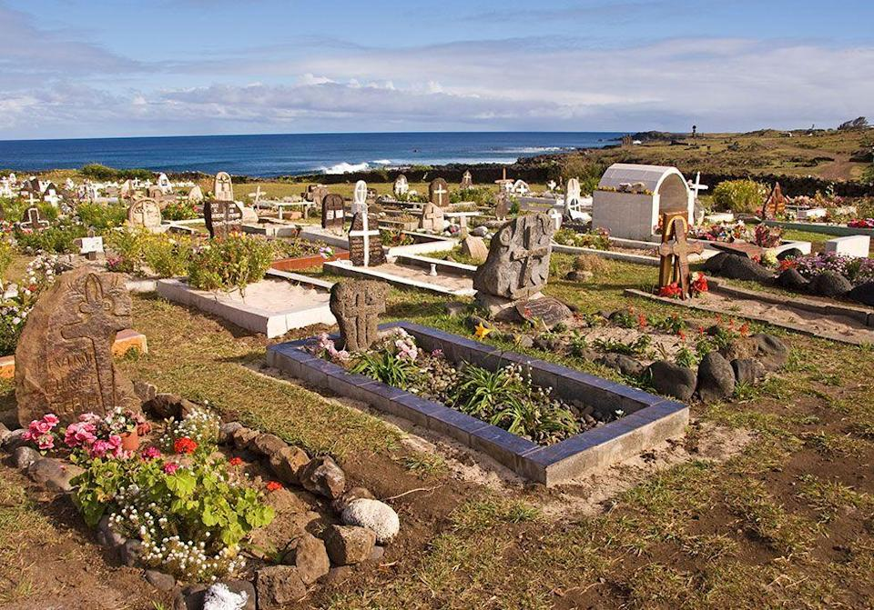 """<p>Residents in the town of Talca ring in the new year by spending the night in a cemetery. Families set up chairs next to the graves of their loved ones to <a href=""""https://www.housebeautiful.com/entertaining/table-decor/g13987252/birth-month-flowers/"""" rel=""""nofollow noopener"""" target=""""_blank"""" data-ylk=""""slk:celebrate the holiday"""" class=""""link rapid-noclick-resp"""">celebrate the holiday</a> by acknowledging how valuable life is.</p>"""