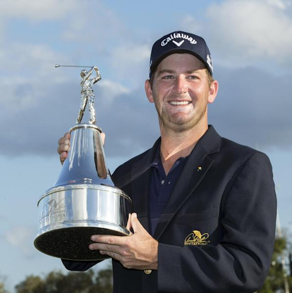 Matt Every holds the trophy after winning the Arnold Palmer Invitational golf tournament at Bay Hill, Sunday, March 23, 2014, in Orlando, Fla. (AP Photo/Willie J. Allen Jr.)