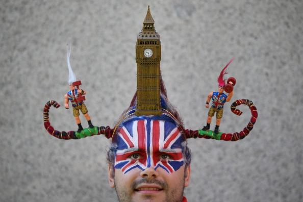 Chris Wilkinson wears a hair sculpture depicting Parliament's Clock Tower known as Big Ben on August 9, 2012 in London, England. Created by Catalonian performance artists Osadia, these sculpted hair pieces are a tribute the success of Team GB in the London 2012 Olympics and will be touring London as part of Showtime a large London outdoor arts festival. (Photo by Peter Macdiarmid/Getty Images)
