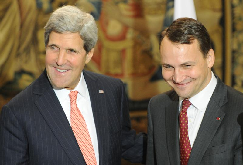 "U.S. Secretary of State John Kerry, left, and Polish Foreign Minister Radek Sikorski share a light moment after a press conference following their talks in Warsaw, Poland, Tuesday, Nov. 5, 2013. Kerry said that Europeans and others have ""legitimate"" questions about the NSA surveillance activities and that those would be answered in private diplomatic discussions. (AP Photo/Alik Keplicz)"