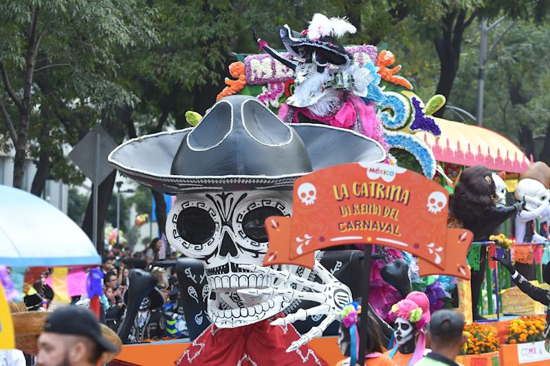 An estimated 300,000 people are said to have attended Saturday's Day of the Dead parade in Mexico City.