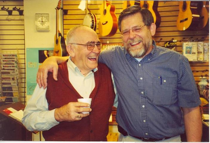 PJ Winther, left, and son Greg Winther at Winther Music in 2001.