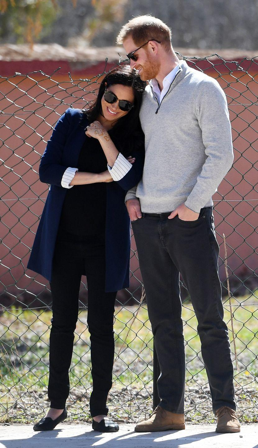 <p>During their royal visit to Morocco, Meghan rested her head on Harry as they watched students play football.</p>