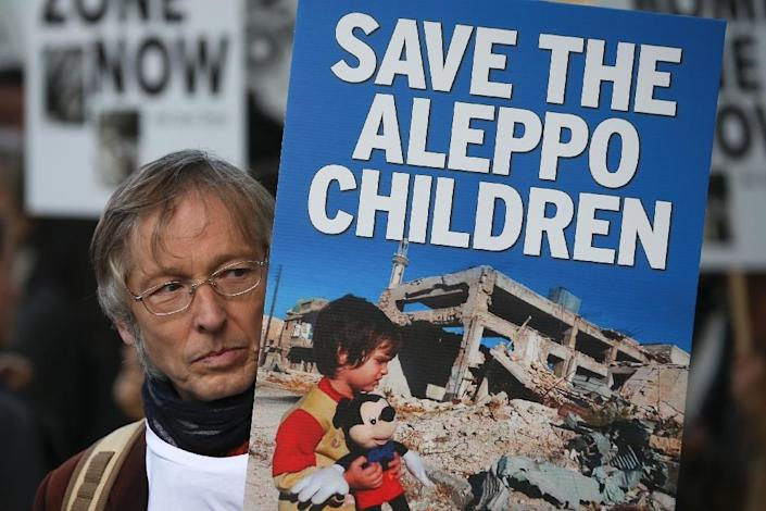 A demonstrator at a protest in London on October 22, 2016, calling on the British government to take action to protect the children of Aleppo (AFP Photo/Daniel Leal-Olivas)